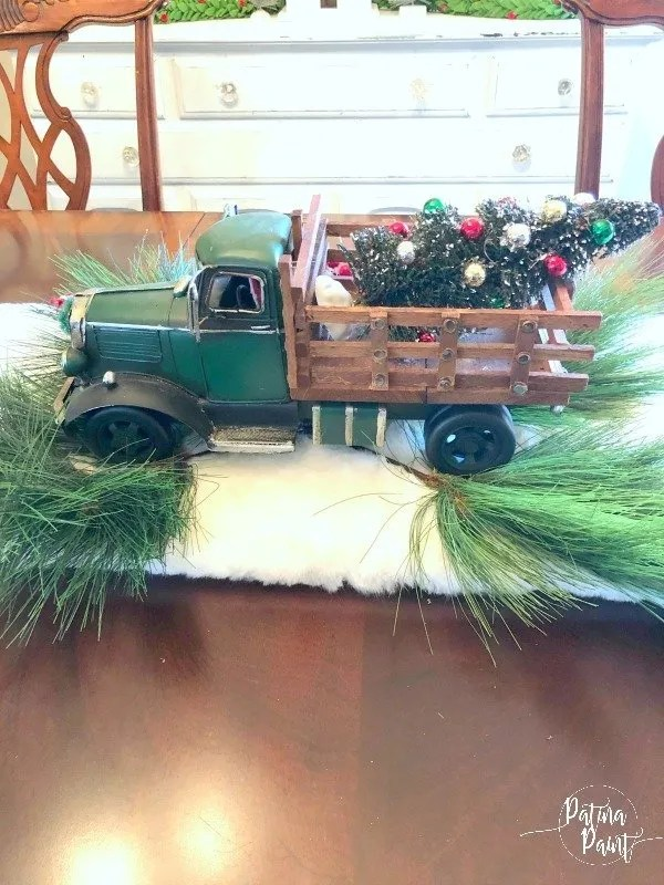 truck in center of a table with greenery