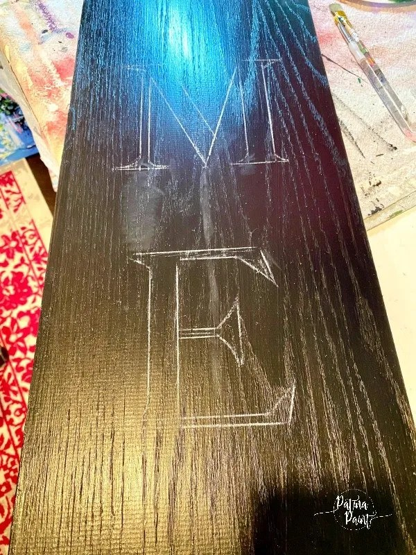 painted black board white letter outline