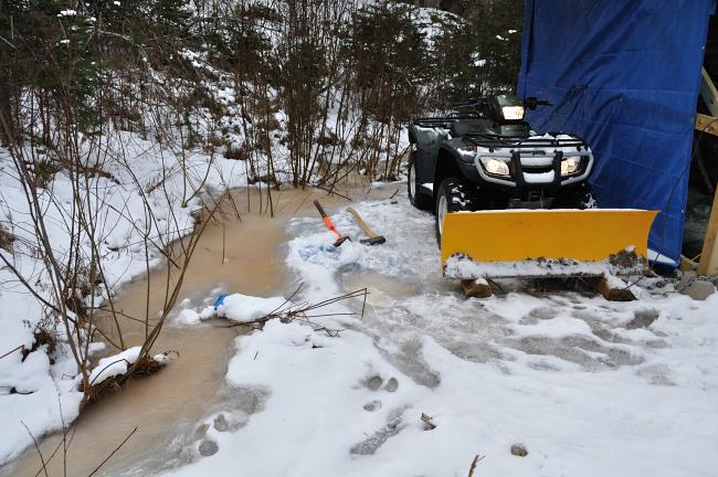 ATV is frozen into the ice!