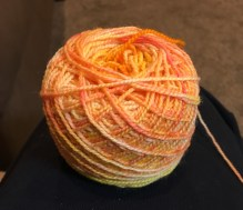 Orangesicle on a base of Franklin Valley Cone Yarns - Superwash