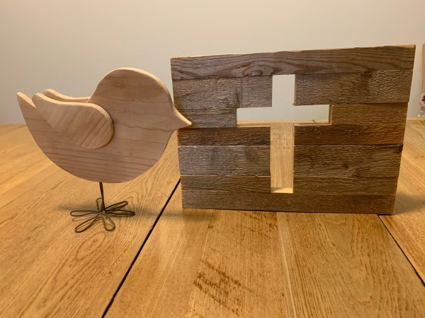 Picture of a wooden bird and a wooden cross