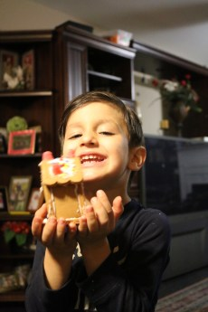 He was so pumped to have gotten a Gingerbread house kit he opened it that night.
