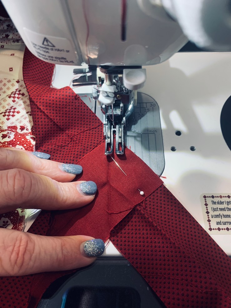 IMG_0112 How to attach a quilt sleeve & binding to a quilt, a tutorial featured by top US quilting blogger, Lisa Bongean