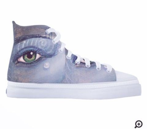 A pair of funky hi tops boots with Lisa Catherwood painting print on, a detailed eye and a droplet.