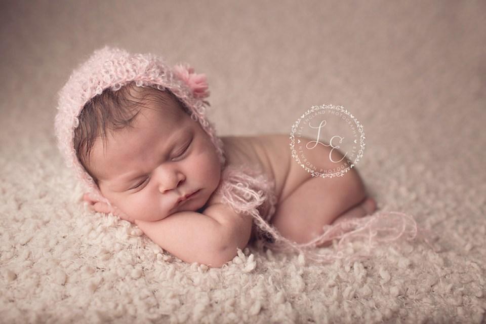 San Diego Newborn Photographer | baby girl on cream with cute pink hat