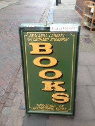 There are other bookshops in town, so they are reassuring you that you've chosen the one that matches the sign you saw from the train