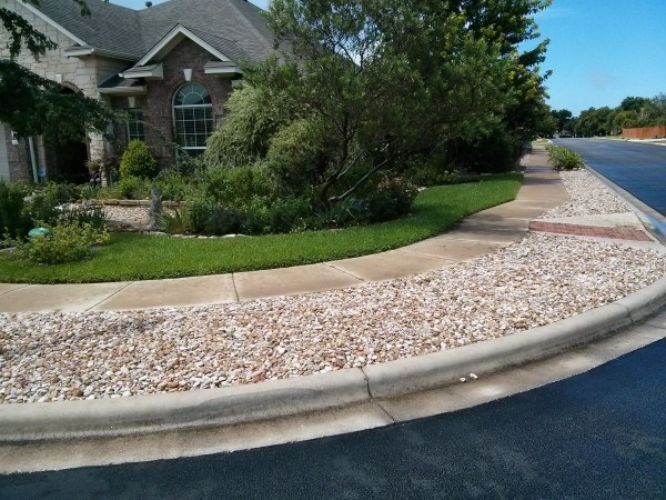 River rock is for NO WATER, NOT NO MAINTENANCE.