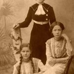 old photo of woman and two girls