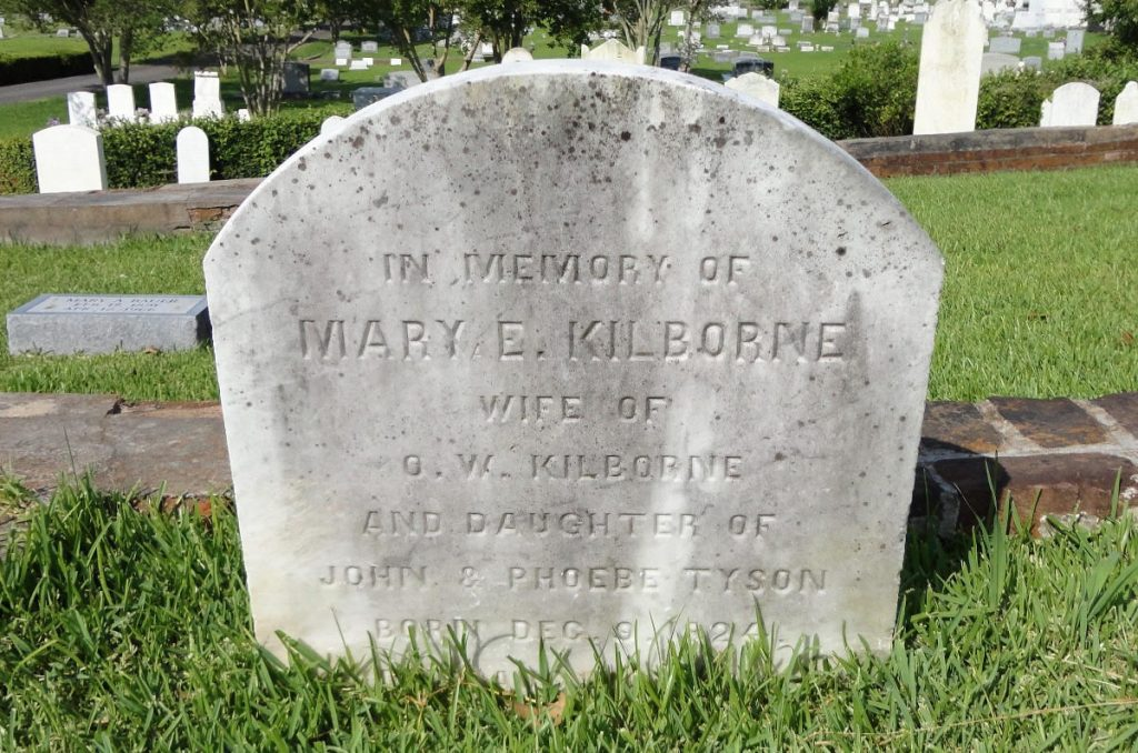 White tombstone reading In memory of Mary E Kilborne, wife of O. W. Kilborne and daughter of John & Phoebe Tyson