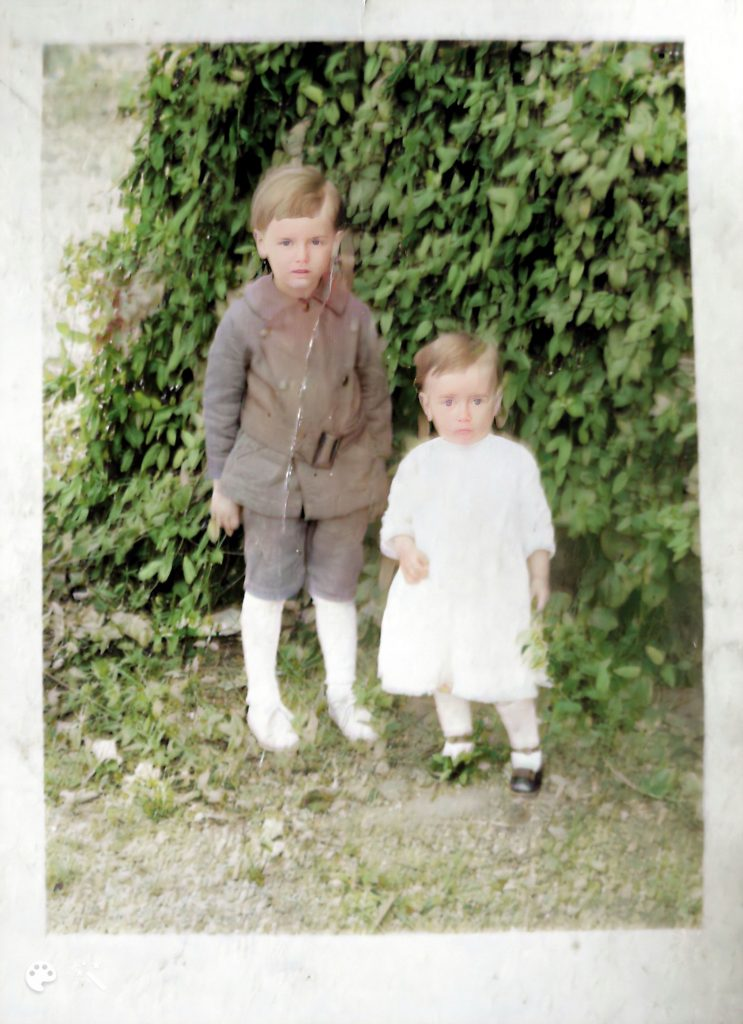 enhanced and colorized photo of 2 boys 's