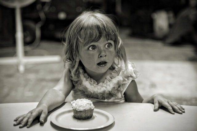 little girl with cupcake
