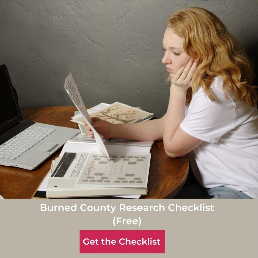 woman studying genealogy chart