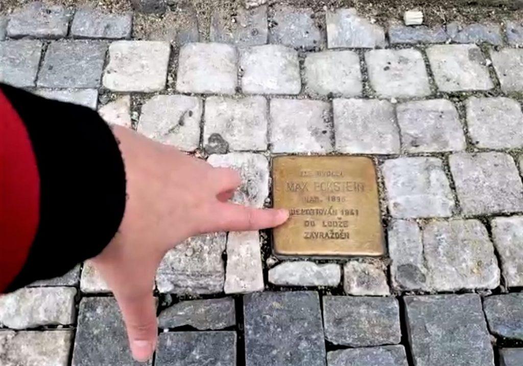 Brass plague known as stumbling stone in sidewalk of Prague, Czech Reublic.