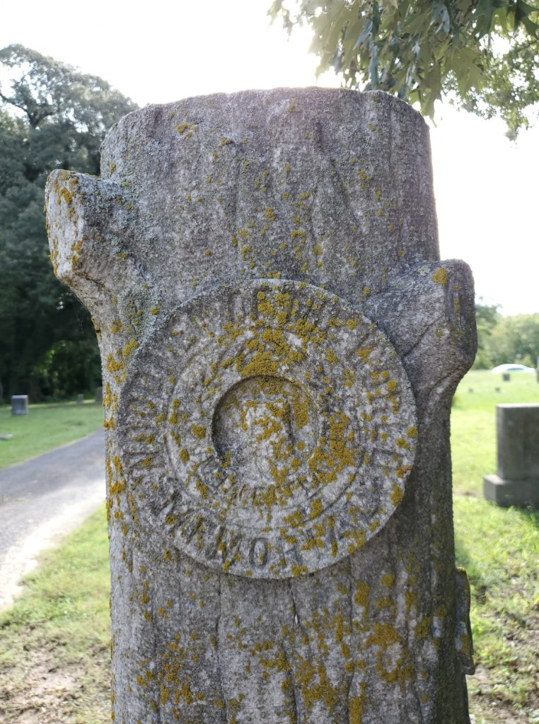 Woodmen of the World Symbol on ancestor's tombstone that looks like a tree trunk
