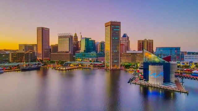 Baltimore's Inner Harbor skyline at sunset.
