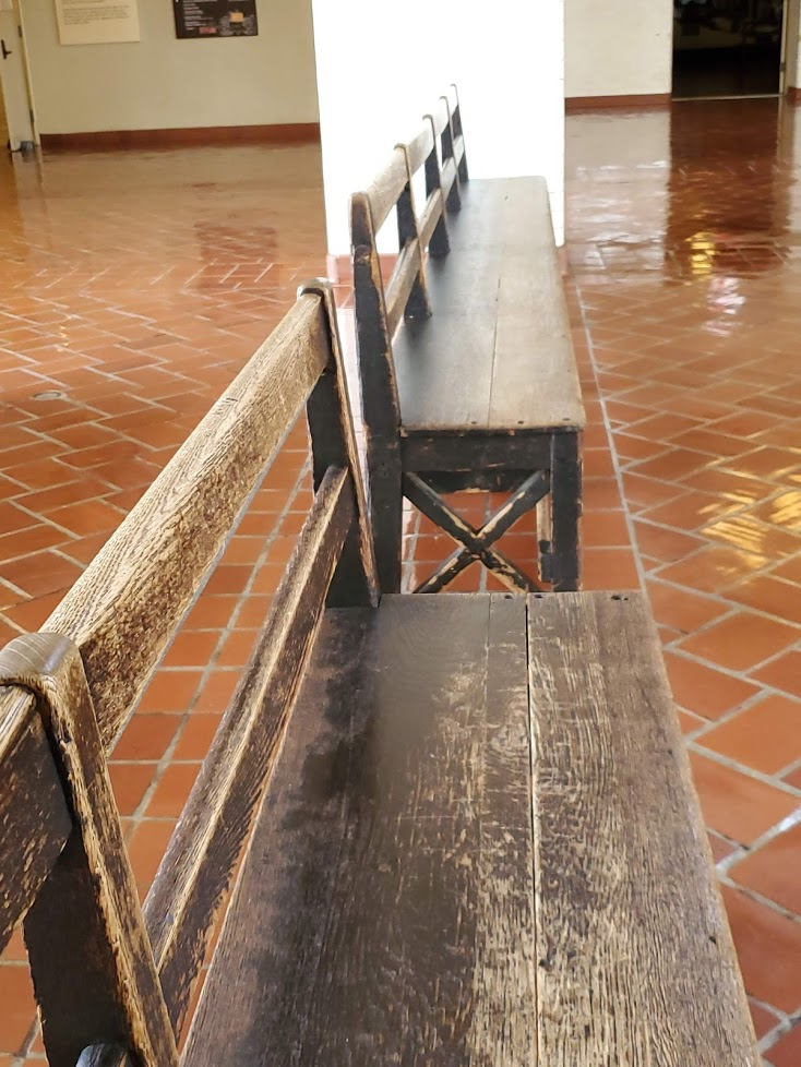 Wooden benches on tile floor in the Grand Hall of Ellis Island