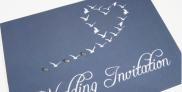 blue wedding invitation with seagulls