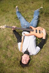 James with electric bass lying on the ground