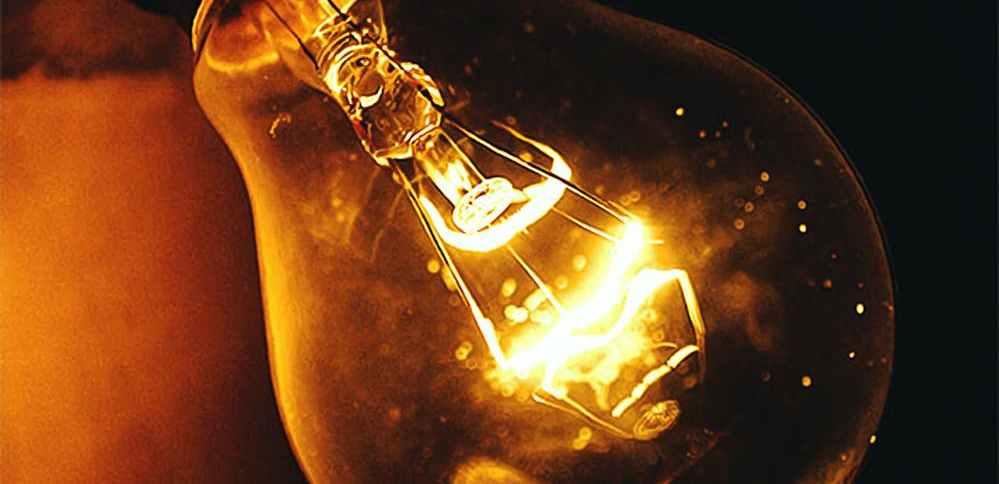 Edison bulb shining in darkness