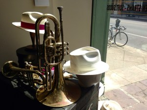 The natural pairing of style and sound in a New Orleans hat shop window.