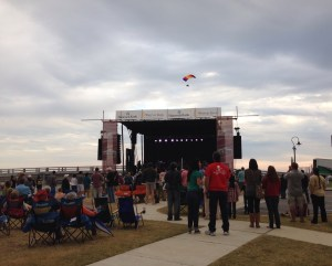 An ultralight flies over the Hancock Bank stage where The Revivalists close out Bay BridgeFest Sunday evening.
