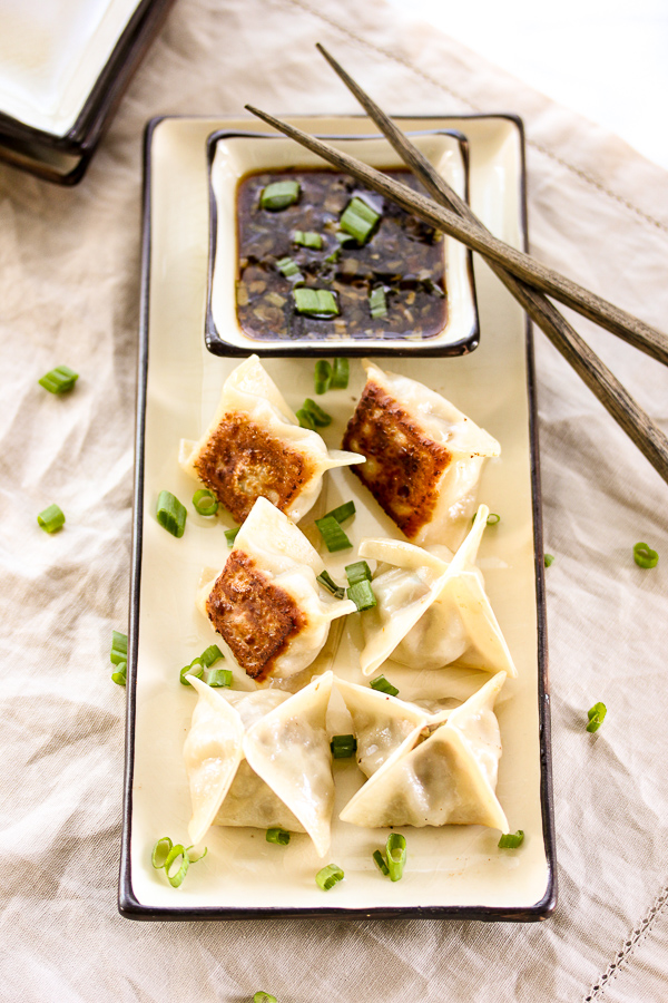 Pork potstickers with sesame soy dipping sauce are perfect for game day.  They're