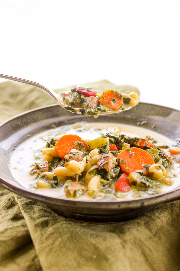 Creamy Italian Chicken Sausage Soup is a hearty and healthy main dish soup that's loaded with veggies and savory flavor. | lisasdinnertimedish.com