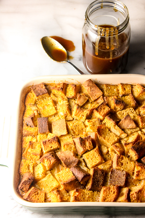 The flavors of pumpkin pie combine to create this decadent Pumpkin Pie Bread Pudding with Homemade Salted Caramel Sauce. | lisasdinnertimedish.com