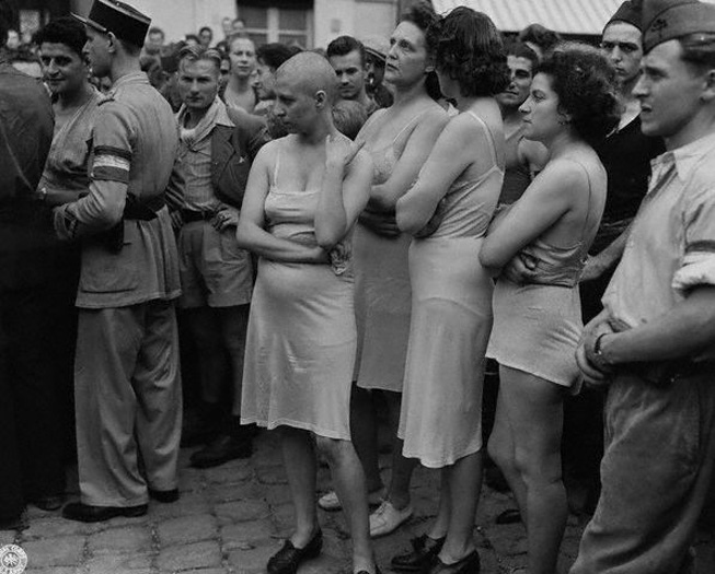 Women accused of being Nazi collaborators are humiliated after the liberation of France, 1944. © Hulton-Deutsch Collection/Corbis