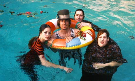 The Mamas and the Papas, from left to right: Michelle Phillips, John Phillips (in tube), Denny Doherty, and Mama Cass Elliot. The sixties pop rock band is remembered for its sweet harmony and enchanting melodies.