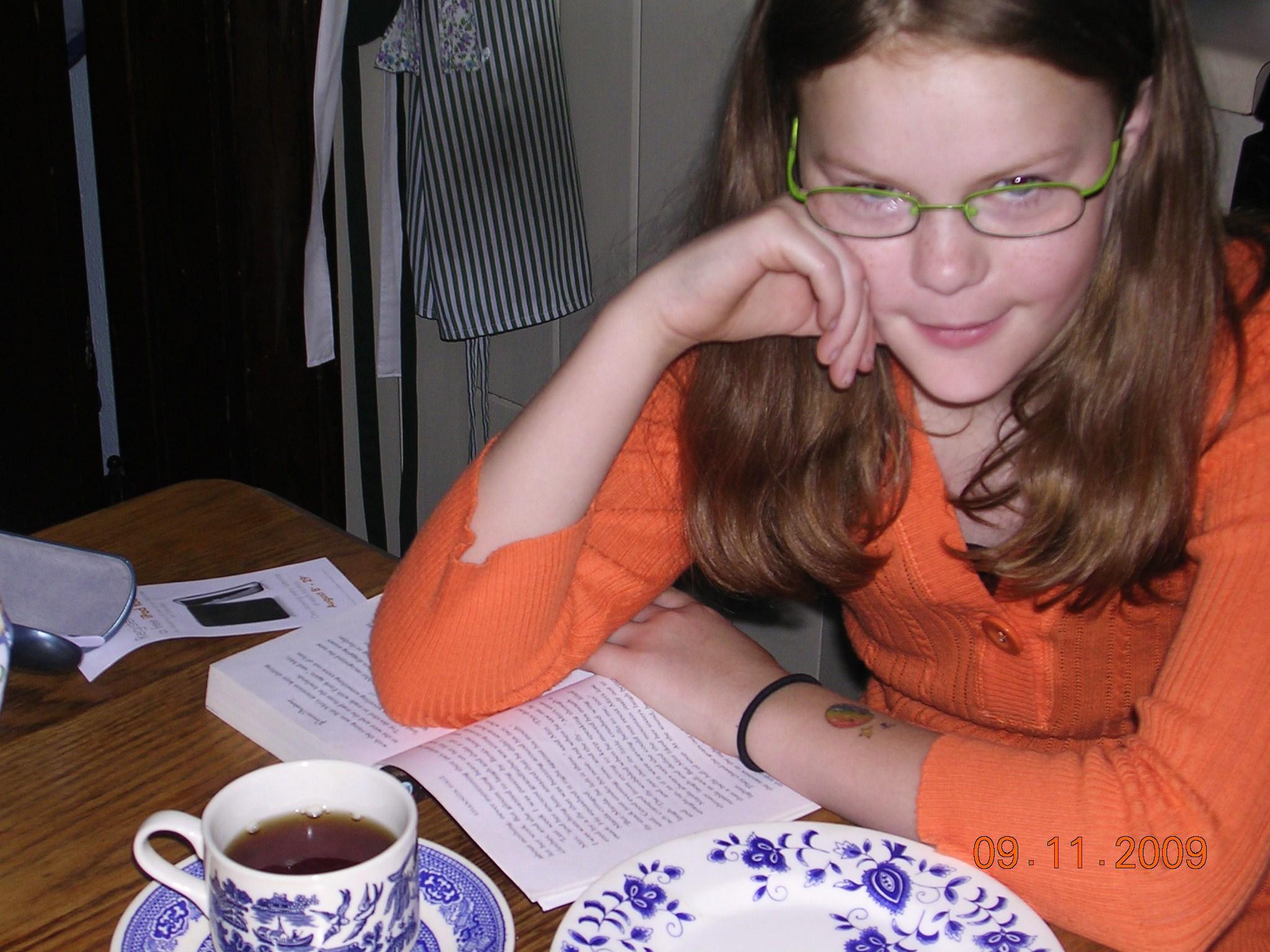 Rose age 10, spending morning tea time finishing homework