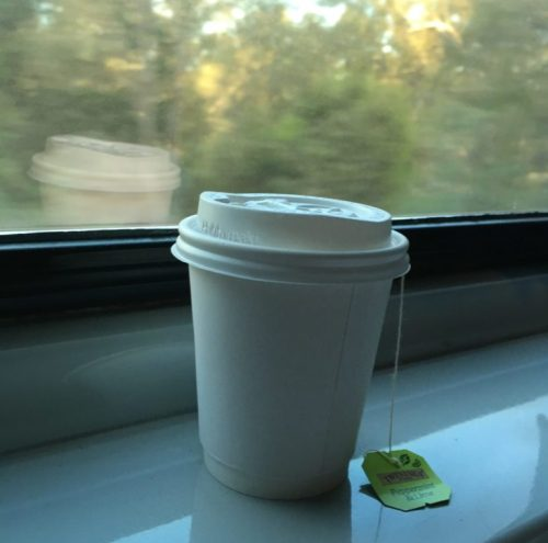 Peppermint tea on a train window-sill