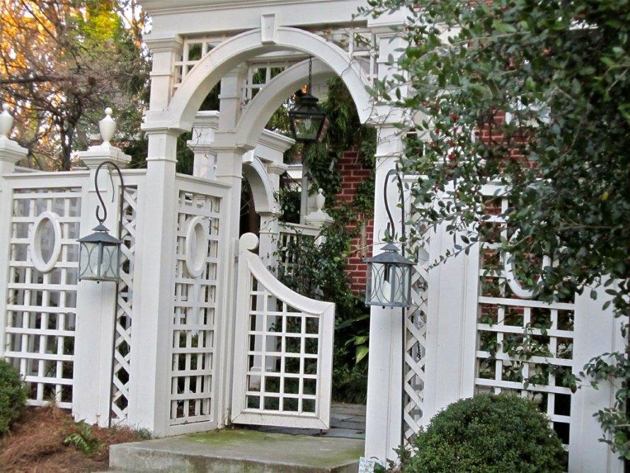 white gate and arbor