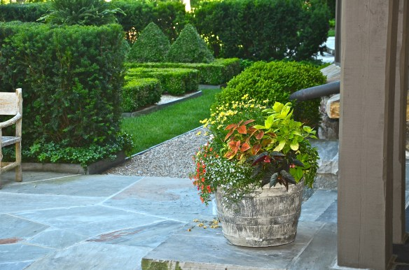 A boxwood garden is located off the back of this wonderful porch