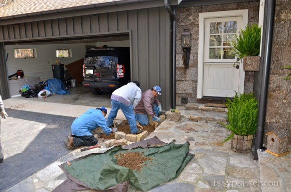 The old fireplace stone will edge the beds