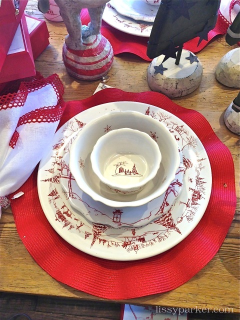 Red ruffled place mats perfectly compliment the color and whimsy of this Christmas table
