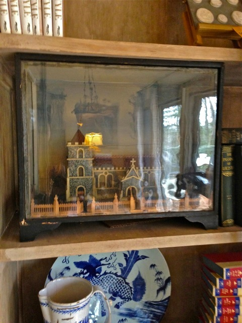 Closeup of the cabinet arrangement—English church diorama has a new home with a collector