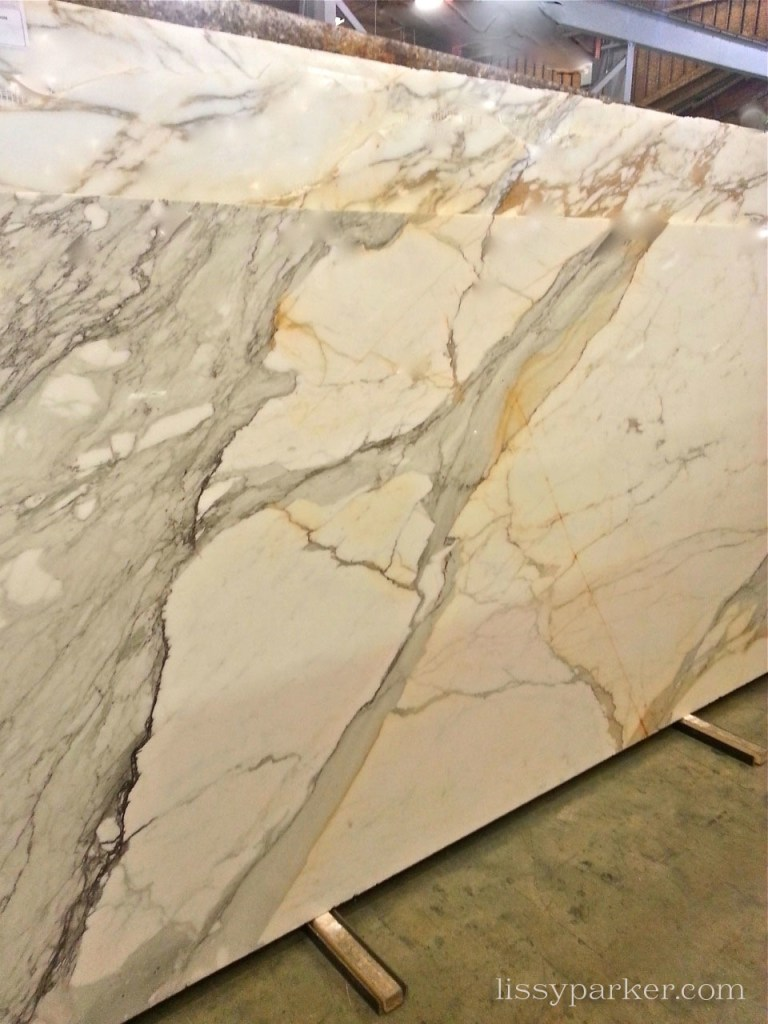 This lovely slab of Calcutta Gold marble will be in the shower
