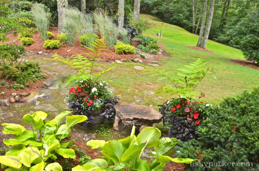 Charming garden leads to a woodland path