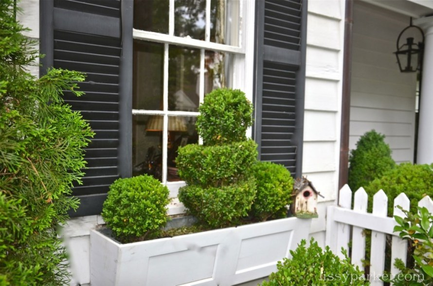 window boxes are filled with swirls of boxwood too