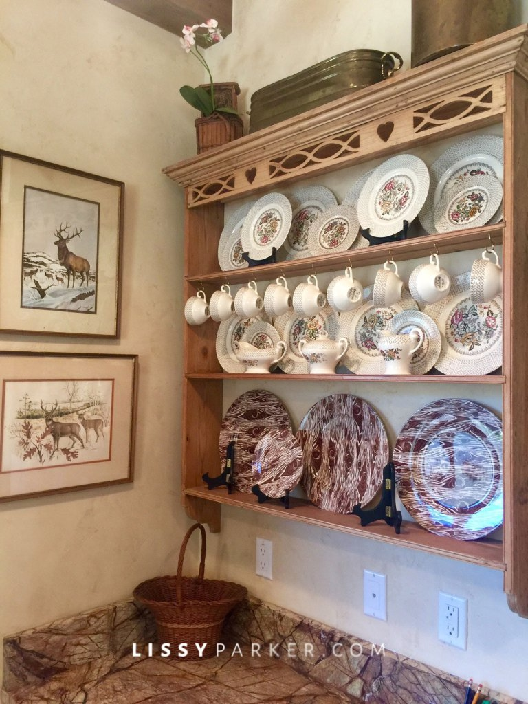 Charming plate rack displays faux bois china