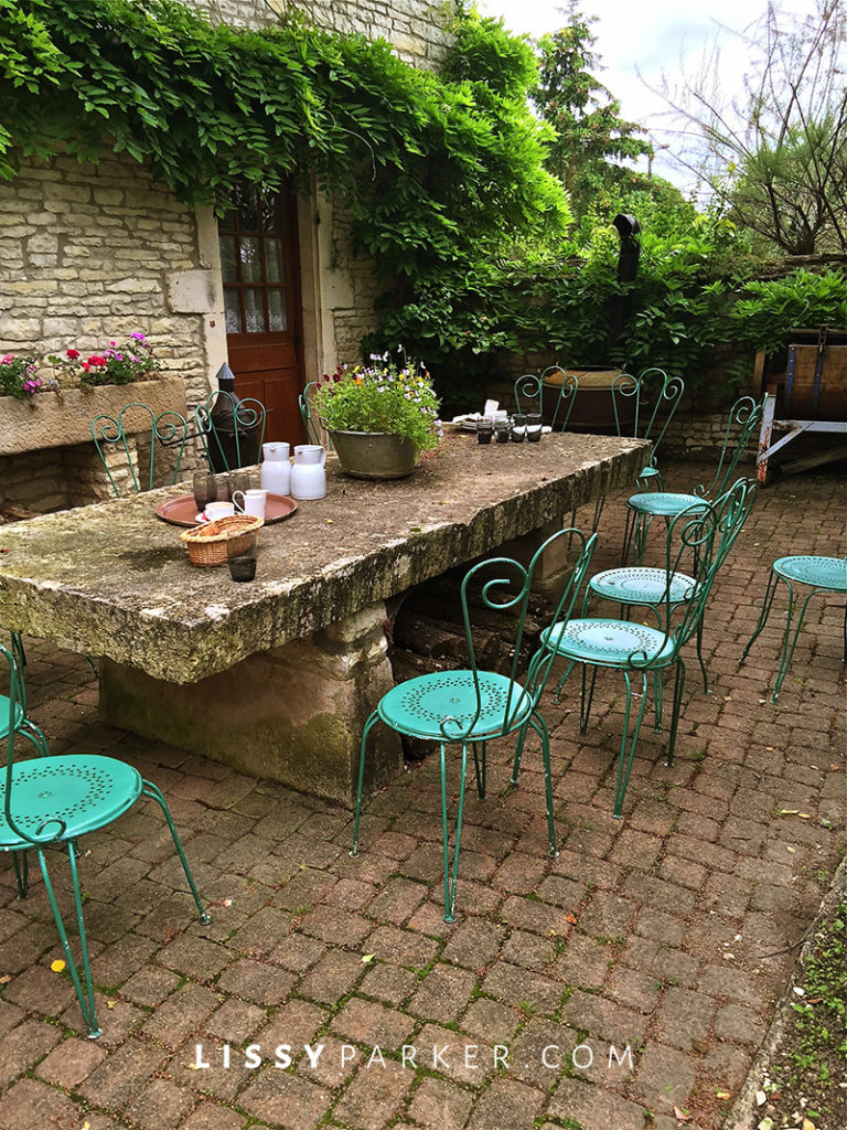 Warm friendly France alfresco dinner on a stone patio