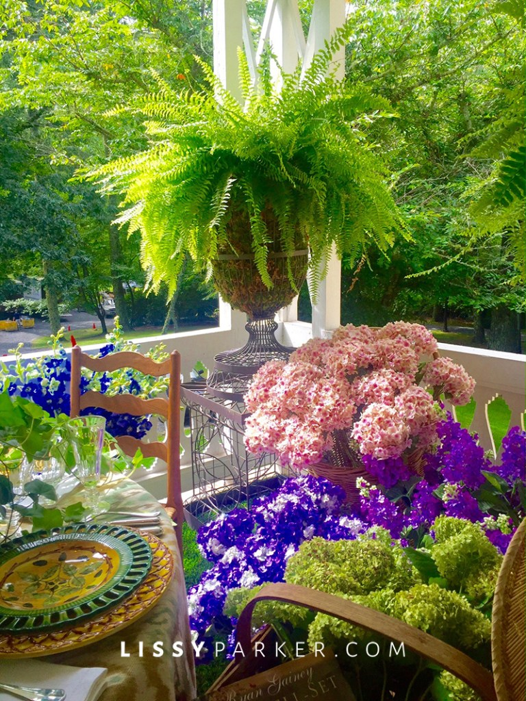 porch filled with ferns and flowers