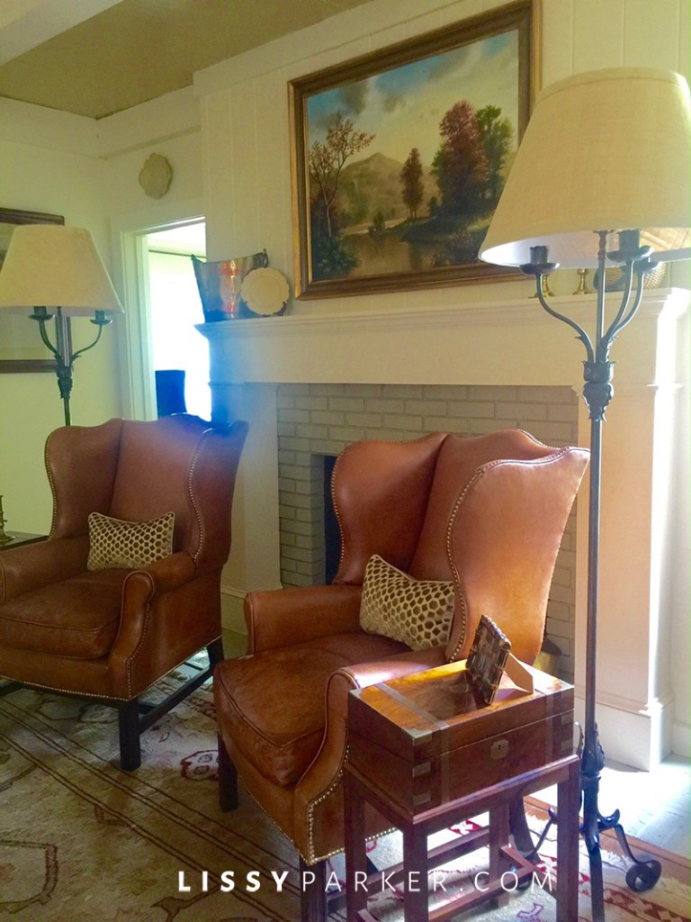 leather chairs by the fireplace