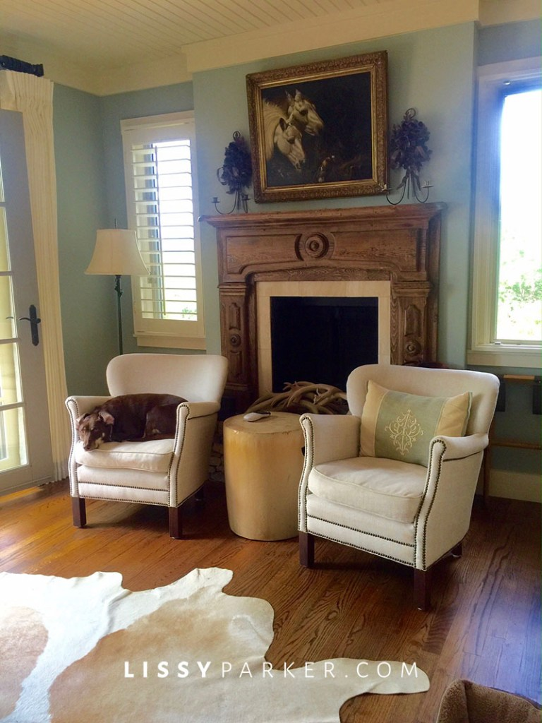 two chairs in front of the fireplace