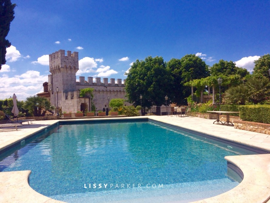 Tuscan castle with a pool and a view