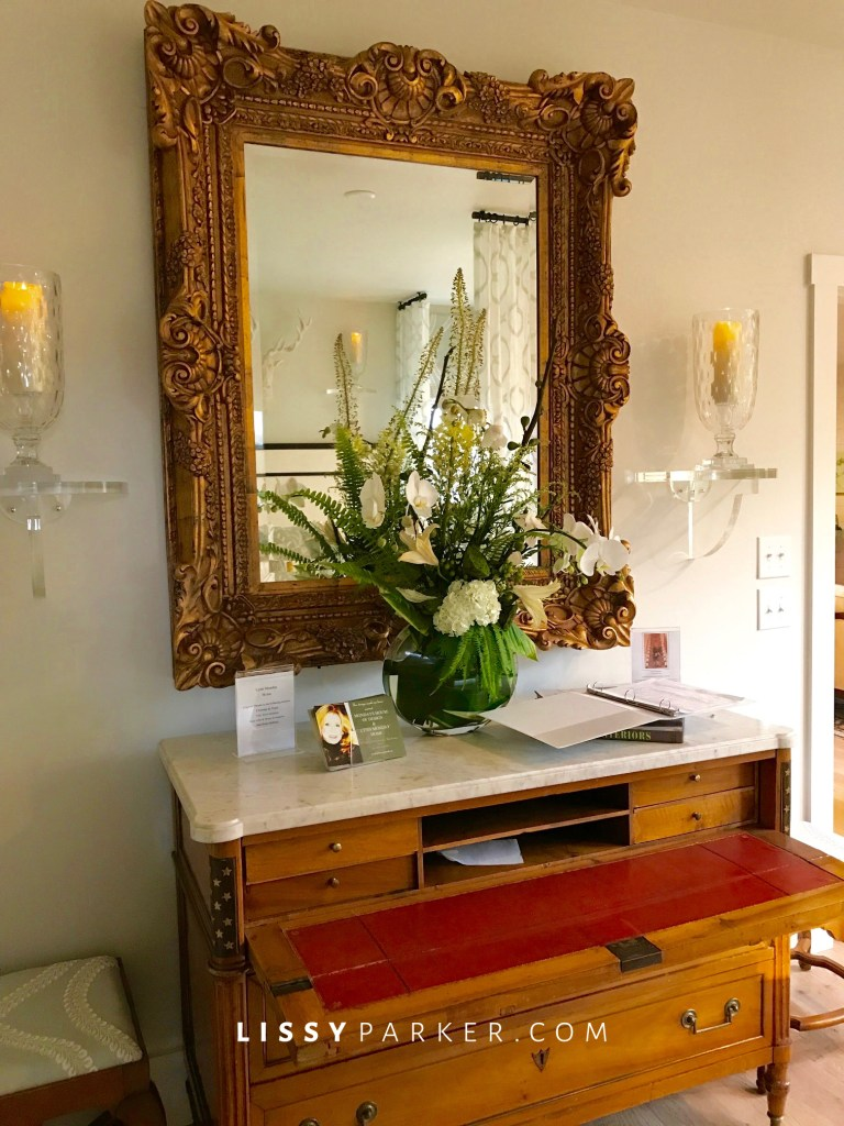 large mirror and marble chest