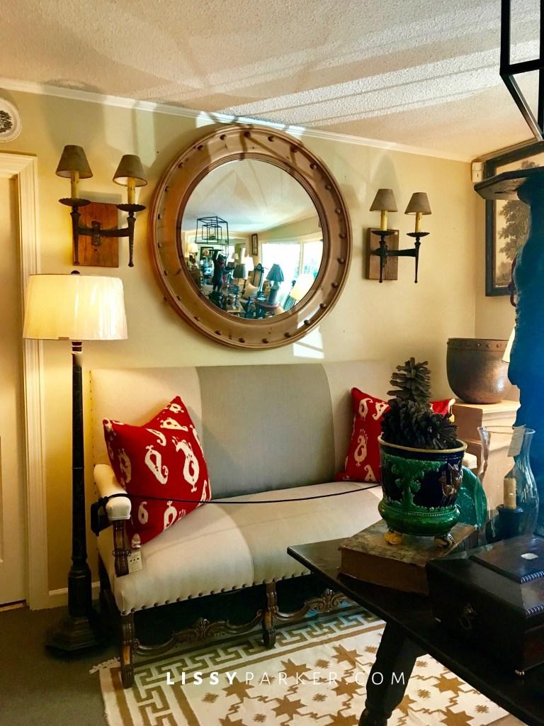 round mirror and sofa
