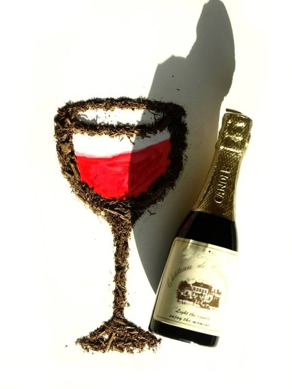 Dirt wine glass and wine bottle