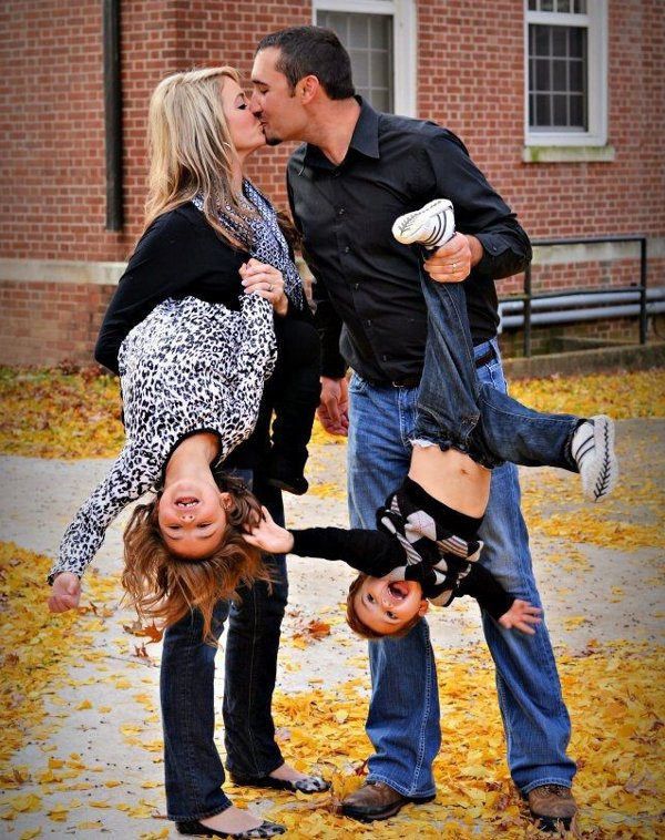 Awkward family photo kids upside down